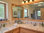 Locally crafted wrought iron fixtures light the master and guest bathroom, both equipped with a bath shower combo.