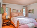 Climb into an elegant wooden 4-post queen size bed, with matching custom curtains, a roman shade and plush duvet.