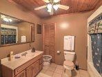 The full bathroom is spacious and equipped with in-unit laundry machines.