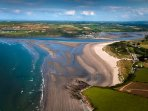Poppit Sands beach from the sky. 5 mins drive from our cottages