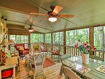 The screened-in porch is the perfect place to enjoy a refreshing beverage while listening to the soothing sounds of...