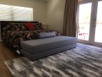 Master Bedroom, with king bed, en suite bathroom, 50' UHDTV and French doors to Sunrise Terracd