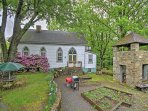 An old bell tower and beautiful yard with blooming flowers and vegetable plots welcome you to the home each time you...