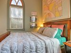 The living area also boasts a partially enclosed additional sleeping space with a queen-sized bed.