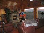 Relax and enjoy your fireplace and 55 inch TV while taking in this view.  This is on the main floor.