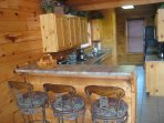 Your cabin's kitchen is stocked with pots, pans, dishes, coffee maker, toaster, spice rack, & more.