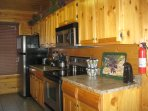 Your kitchen is fully equipped with stainless-style refrigerator, oven, dishwasher and microwave.