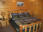 Your cabin's master suite features a king-sized bed, wall-mounted LED TV and private full bathroom.