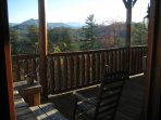Enjoy a meal & listen to the birds while relaxing on your private cabin deck outside the lower level