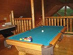 You cabin's loft features a pool table and air hockey game.  There are also board games and puzzles.