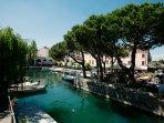 The inner port of Desenzano del Garda with restaurants and terraces