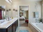 Master bath w/double vanity and soak tub.