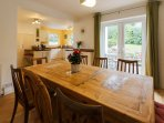 Open plan kitchen dinner with french doors leading to the garden.