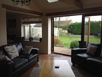 Oak Beamed lounge with fully opening Bi-fold doors onto garden giving you that open air feeling
