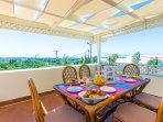 Dining area with sea & mountain views on our 100 m2 Veranda .