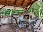 Back covered deck with full BBQ kitchen and gas fireplace.