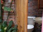 Outdoor Toilet with Bamboo Door