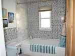 Bath with integral shower