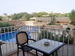 Terrace overlooking pools and garden