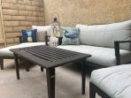 Courtyard patio with comfortable seating to relax after a day at the beach