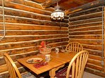 Dine in surrounded by original Hand Hewn Log Cabin Walls