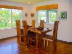 Dining area with impressive koa wood dining set