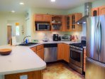 Kitchen is a home cook's dream with high end appliances, plenty of counter space.