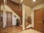 The entry is gorgeous with bright hardwood and stairs leading to the upstairs.