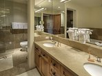 The ensuite bathroom for the upstairs master features dual vanity, walk in shower and a jetted tub.