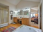 The master bath features a walk-in shower, soaking tub and spacious Jack-and-Jill vanity sinks.