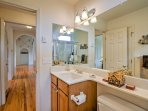 The guest bath features an extending mirror, sink and walk-in shower.