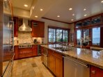 The gourmet kitchen is fitted entirely with professional grade Viking appliances.