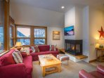 Cozy up on the comfy couches in front of the gas fireplace.