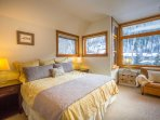 This spacious Master Bedroom #1 has a king bed and overlooks the town.