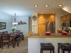 Keep everyone nearby with the dining area, kitchen, and breakfast bar.