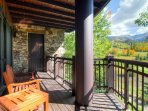 The private balcony to Master Bedroom #1 sports incredible views of the golf course and the mountains beyond.