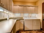 There's a laundry room with a sink and a washer and dryer for your convenience.