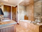 In the private bathroom to Master Bedroom #1, you can take a long bath or a quick shower. Or a long shower. Or a quick...