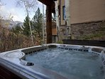 Soak in the covered private hot tub and take in spectacular views of the surrounding mountains.