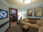 Watch skiers go big on the big flatscreen TV in that new Warren Miller movie while you relax on the big couch in the...