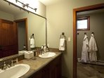 The private bathroom to Guest Bedroom #2 has a double vanity and a tub/shower combo.