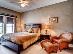 The master bedroom features a king bed, TV, a private bath and the perfect place to relax.