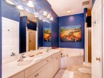 Not to be outdone, the master bathroom features a large jetted soaking tub, separate shower, and a double vanity.