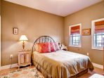 The second guest bedroom features a queen bed and good natural light.