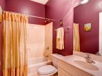 The second bathroom is accessible from living area, and serves both guest bedrooms as well.