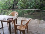 Enjoy chai and pakoras on the deck or just curl up and read a nice book from the mini library.