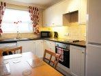 Fully fitted kitchen includes full size fridge and freezer, washing machine etc.
