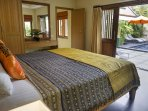 Lovely Bedroom opens out to pool