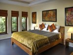 Beautiful Bedroom with air conditioning and ceiling fan