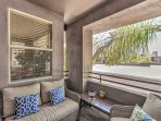 The second-floor condo's private patio has comfortable seating to relax.
